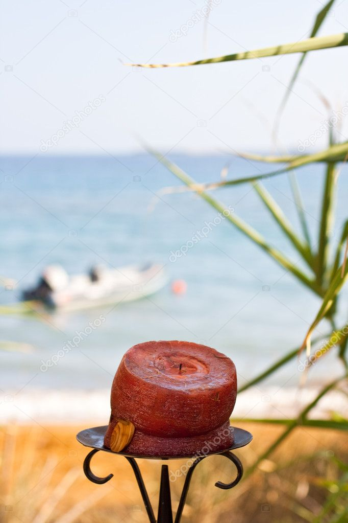 Red candle on the beach  Stock Photo #1454729