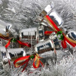 Christmas bell in silver garland — Stock Photo