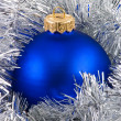 Blue christmas balls in silver garland — ストック写真