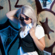 Blond woman in front of grafitti — Stock Photo