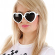 Stock Photo: Pretty young girl in white sun glasses.