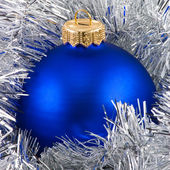 Blue christmas balls in silver garland — Stock Photo