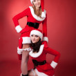 Two sexual women in dressed as Santa. — Stock Photo #1467017