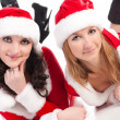 Two girl friends in christmass costumes. — Stock Photo #1467019