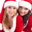 Stock Photo: Two girl friends in christmass costumes.