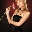 Beautiful girl with a flower — Stock Photo