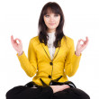 Royalty-Free Stock Photo: Businesswoman exercising yoga .