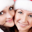 Two girl friends in christmass costumes on white — Stock Photo #2008003