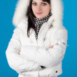 Woman in winter clothes. On blue — Stock Photo #2008684