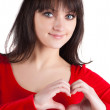 Stock Photo: Woman showing heart symbol.