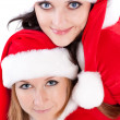 Two girl friends in christmass costumes. — Stok Fotoğraf #2008929