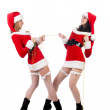 Foto Stock: Two girl friends in christmass costumes.