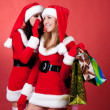 Two women in dressed as Santa, with shopping bags — Foto Stock