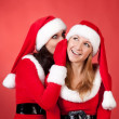 Two happy young Santa girl talking — Stock Photo