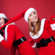 Two women in dressed as Santa, with shopping bag — Stock Photo