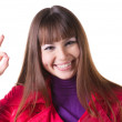 Royalty-Free Stock Photo: Brunette in red showing ok gesture.