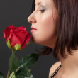 Pretty woman with rose. — Stock Photo