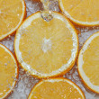 Stock Photo: Fresh water drops on oranges