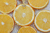 Fresh water drops on oranges — Stock Photo