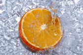 Fresh water drops on orange — Stock Photo