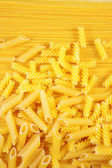 Macaroni on long spaghetti. — Stock Photo