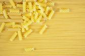 Macaroni on long spaghetti. — Stock Photo