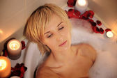 Nude woman in foamy bath — Stock Photo