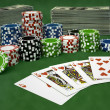 Flush Royal on a green casino table — Stock Photo