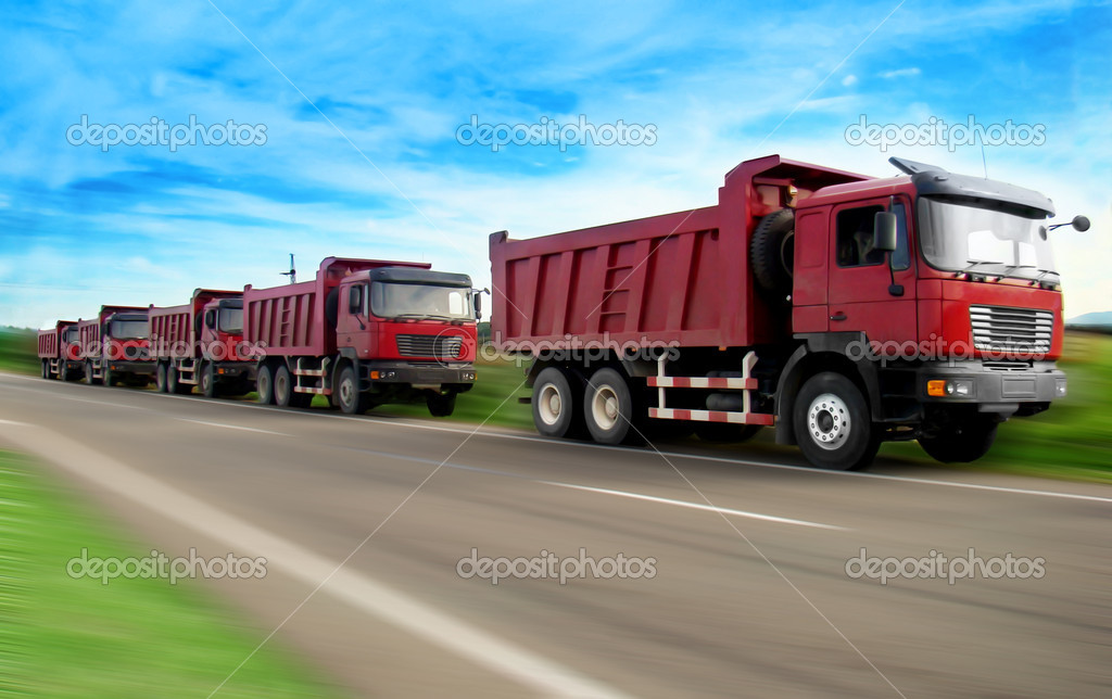 Five red truck on a road — Stock Photo #1452033