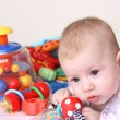 Baby and heap of toys — Stock Photo #1701700
