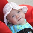 Stock Photo: Happy baby girl in pram
