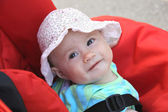 Happy baby girl in pram — Stock Photo