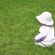 Little girl on green grass — Stock Photo