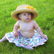 Baby girl wearing big hat — Stock Photo