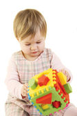 Baby girl with colorful sorter toy — Stock Photo