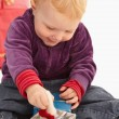 Stock Photo: Baby playing with christmas presents