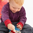 Baby playing with christmas presents — Stock Photo