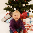 Christmas - Cute child opening Gifts — Stock Photo