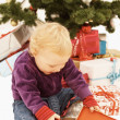 Surprised kid opening christmas gifts — Stock Photo #1460420