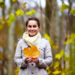 Fashionable young woman holding Leaf — Stock Photo