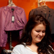 Young woman in clothing store — Stock Photo