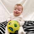 Stock fotografie: Cute little baby boy playing with toy