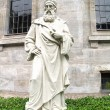 Old stone statue of a bishop or priest — Stock Photo