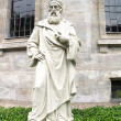 Old stone statue of a bishop or priest — Stock Photo #1460541