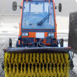 Snow sweeper tractor in Denmark - Stock Photo