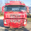 Stock Photo: Front view of red truck in urbarea
