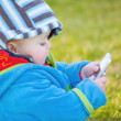Foto Stock: Colourful baby boy playing with mobile