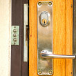 A modern day lock on a front door — Stock Photo