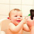 Royalty-Free Stock Photo: Excited baby boy videoed having a bath
