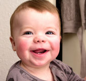 Closeup Portrait of a smiling baby boy — Stock Photo